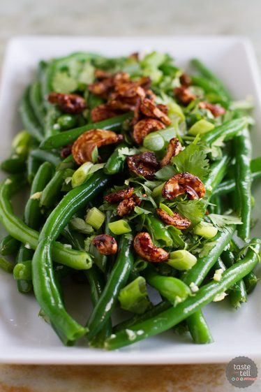 An Asian take on green beans, this Fresh Green Bean Salad with Asian Dressing is full of Asian flavors and great texture from the Soy-Glazed Cashews.