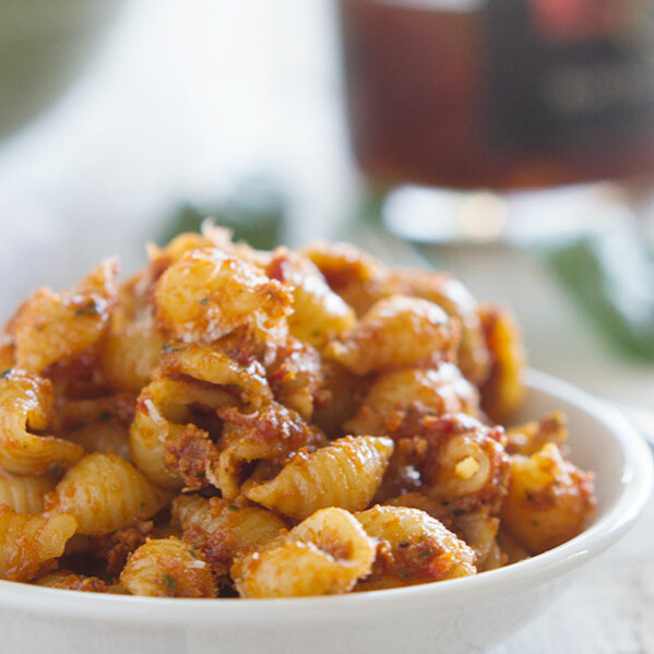 A simple sun dried tomato pesto is combined with pasta in this easy side dish that everyone will love. It is a perfect for picnics and pot lucks and can be served warm or cold.