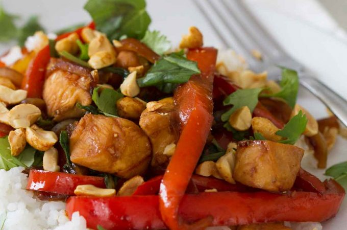This Spicy Thai Chicken is a go-to every summer - a Thai inspired dish with chicken, bell peppers and lots of basil.