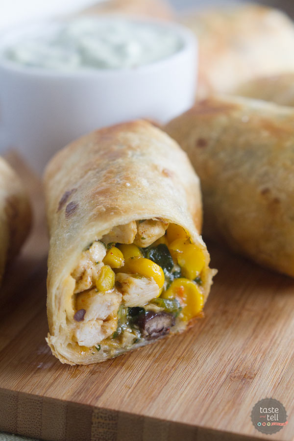 Filled with chicken, corn, black beans, spinach and a whole lot more, these Southwestern Egg Rolls are an appetizer that will become the hit of the party!