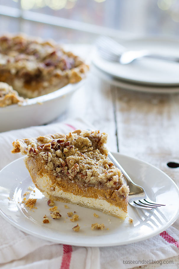 Pumpkin Cheesecake Pie - Cheesecake and pumpkin pie combined! A cheesecake layer is topped with a pumpkin pie layer and then a layer of streusel. Perfect for any holiday!