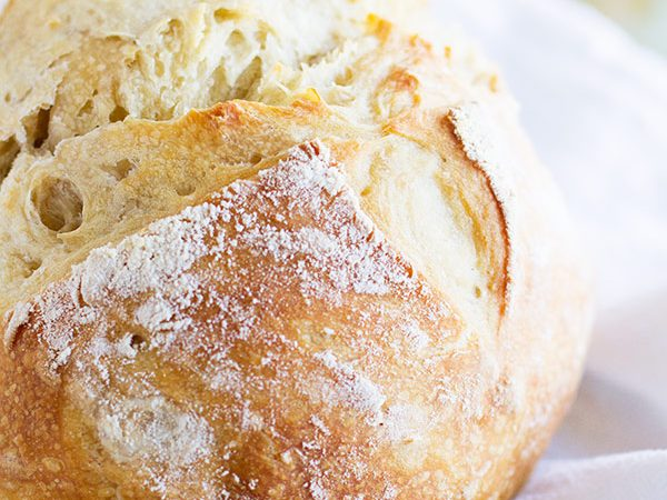 No need to visit the fancy bakery when you can make this Artisan Bread Recipe at home!! The dough comes together in 5 minutes and can be refrigerated for 14 days, making it easy to have freshly baked bread every night!