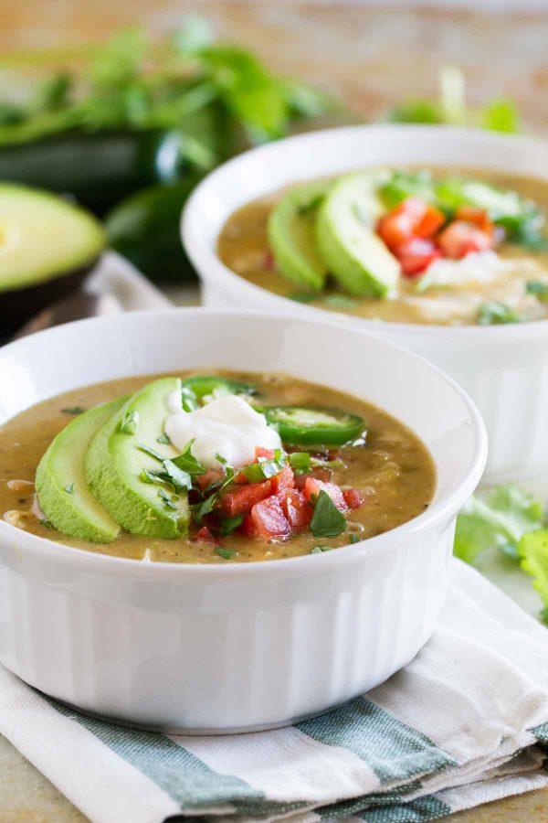 This Chicken and White Bean Chili is a spicy white green chili and jalapeño chili that will heat you up on an cold day!