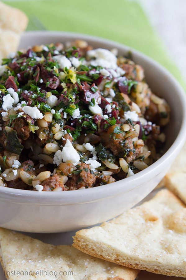 This Greek Goulash is a fun take on traditional goulash - with a hearty, beefy tomato sauce, orzo, and a refreshing Greek gremolata. Serve it up with some baked pita chips for a filling dinner.
