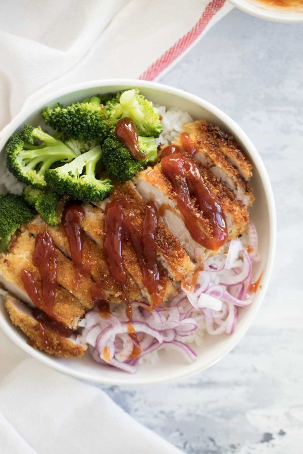 Rice bowls with sweet and sour pork, pickled onions and broccoli