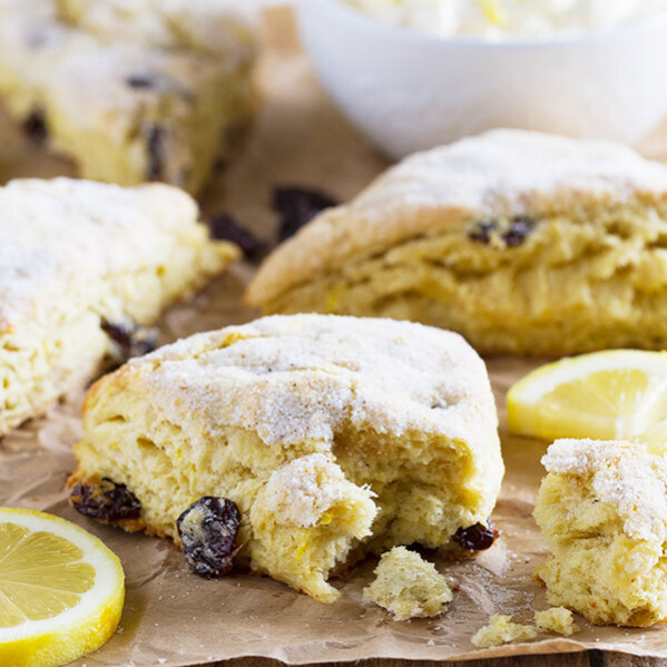 Tender and flaky, these Lemon Scones with Nutmeg and Cherries are not too sweet and perfect for breakfast or brunch. Served with a creamy spread, these scones are irresistible!