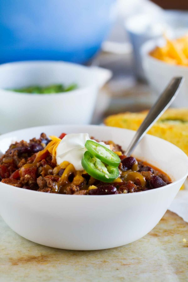 The perfect all-around chili recipe, this Warm You Up Beef and Bean Chili has all of your favorite chili ingredients, plus some bacon for added smokiness.