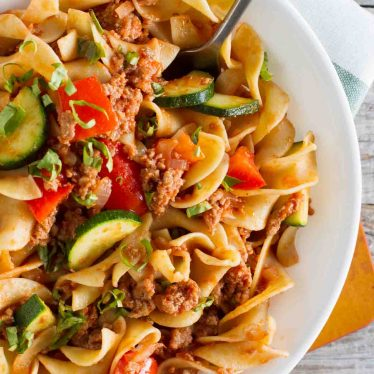 Lighten up a bit with this American Turkey Goulash Recipe that is filled with vegetables. Comfort food that is better for you than the original - but it's definitely not lacking on flavor!