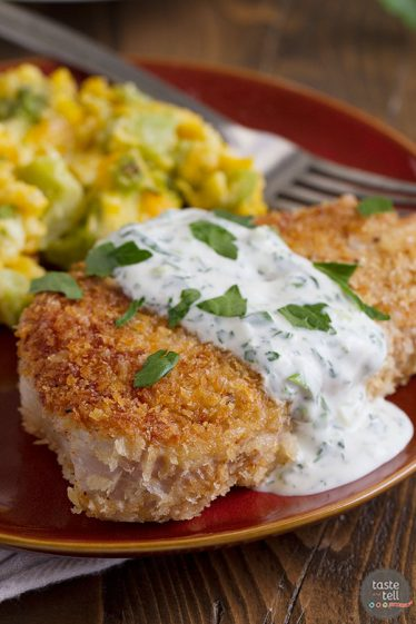 Boneless pork chops are coated in panko bread crumbs and served with a creamy dressing in this recipe for Panko Pork Chops with Creamy Herb Dressing.