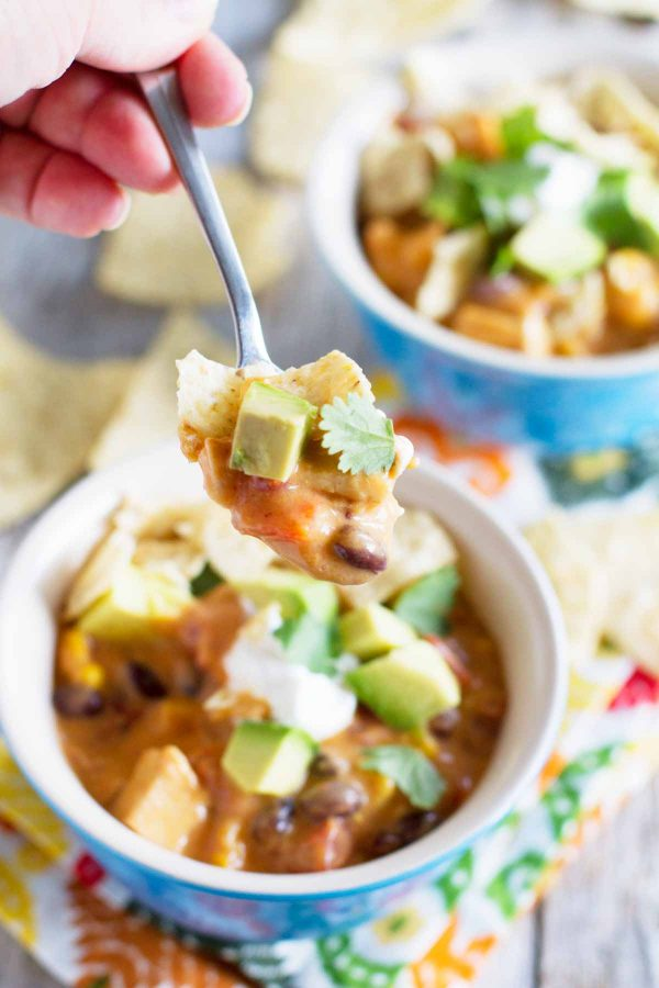 Filled with the flavors of chicken enchiladas, this Slow Cooker Chicken and Cheese Enchilada Soup is super easy to make and slow cooks all day for maximum flavor.