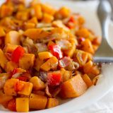 The perfect Sweet Potato Hash – sweet potatoes are combined with bacon, onions and sweet red peppers in this easy stovetop side dish.