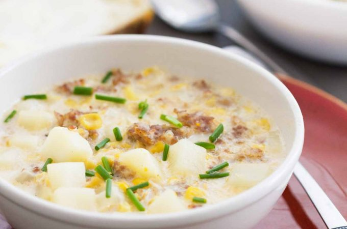 photo of corn and sausage chowder in a bowl