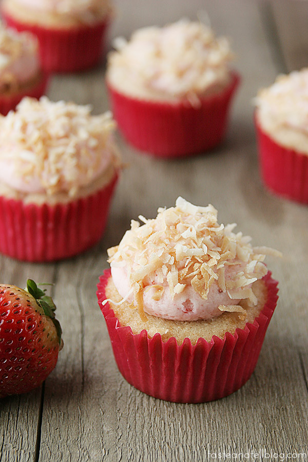 Take a trip to the tropics with these super moist and delicious cupcakes - these Strawberry Colada Cupcakes are filled with strawberry, coconut and pineapple.