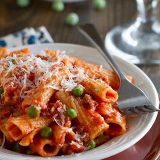 This Rigatoni with Sausage, Peas, Tomatoes and Cream is easy enough for a weeknight, but special enough for a weekend.