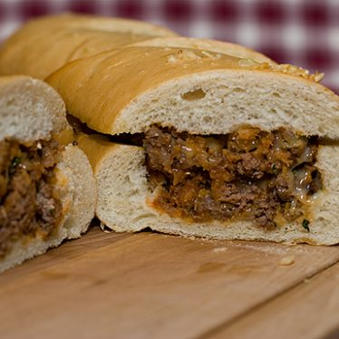 Sausage and Beef Stuffed French Loaf | www.tasteandtellblog.com