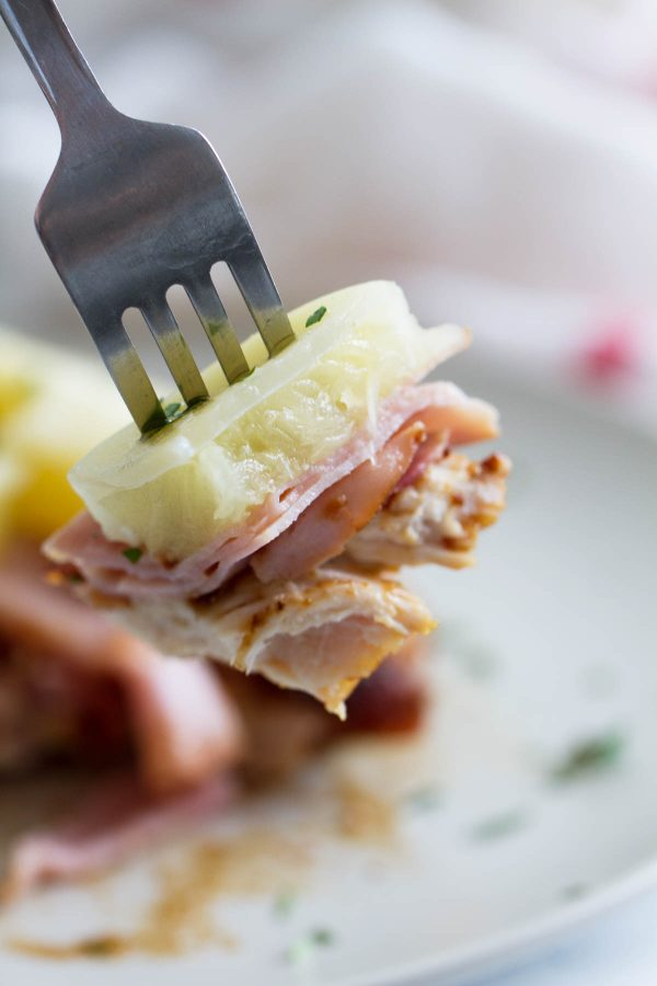 Dinner in a hurry - this Hawaiian Chicken with Ham and Pineapple cooks up in less than 30 minutes. Soy sauce seasoned chicken is topped with ham, pineapple, and melty cheese for a dinner you'll want to make over and over again.