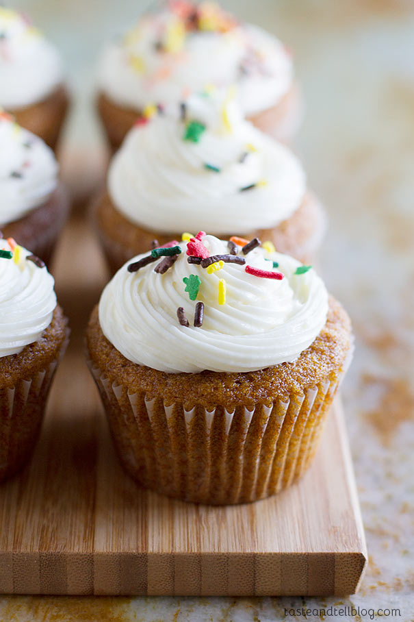 Pumpkin Cupcakes with Cream Cheese Frosting - The perfect pumpkin cupcakes, filled with warm fall spices and topped with a creamy cream cheese frosting.