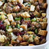 casserole dish of sausage stuffing with apples and cranberries