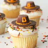 Cupcakes topped with edible Pilgrim Hats