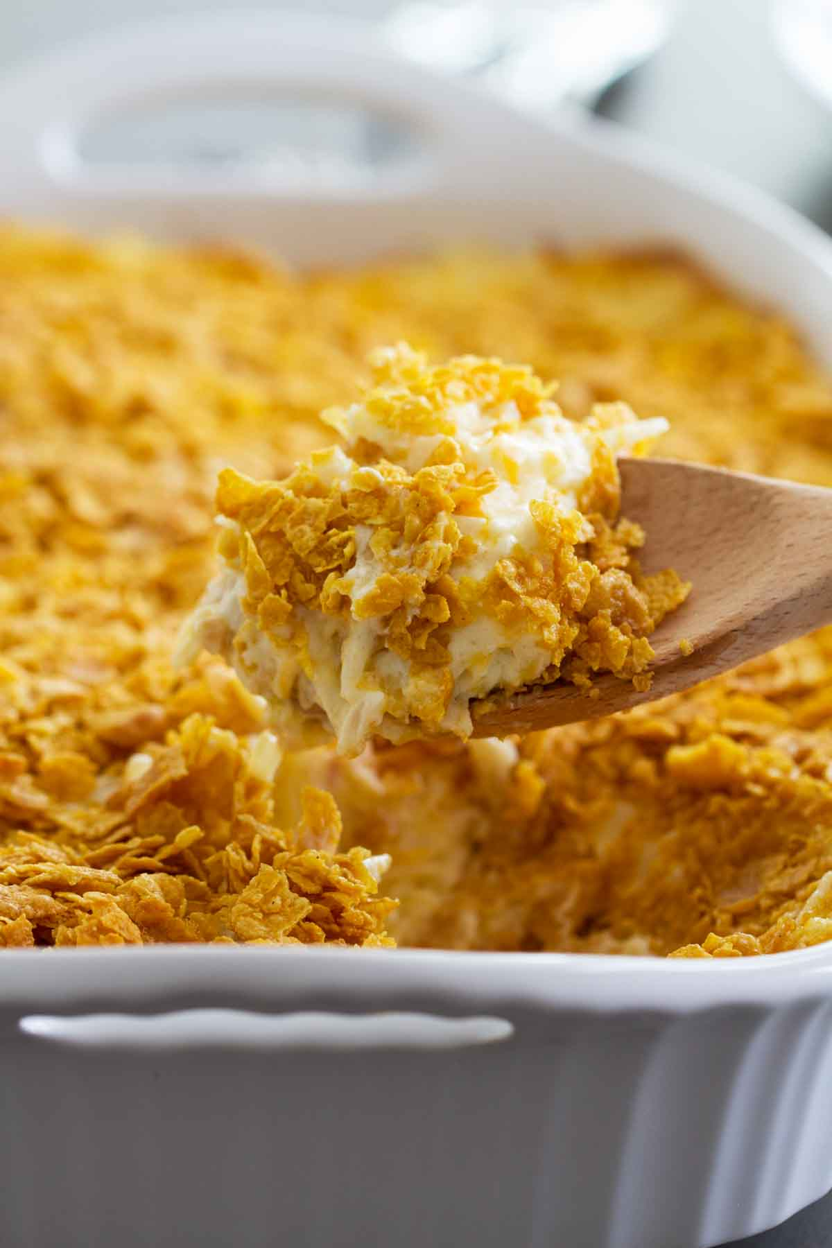scoop of funeral potatoes in a casserole dish