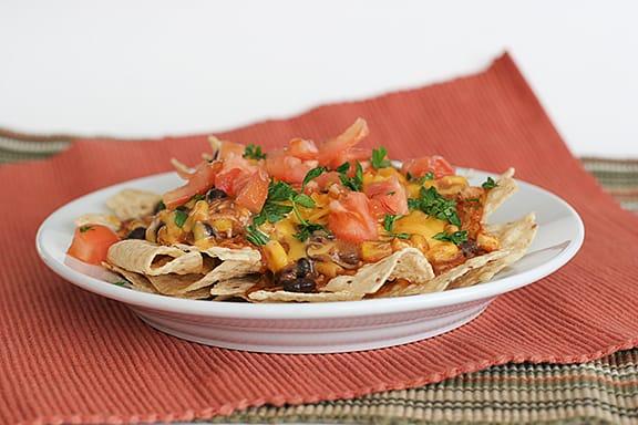 Quick Chicken Enchilada Nachos | www.tastenadtellblog.com