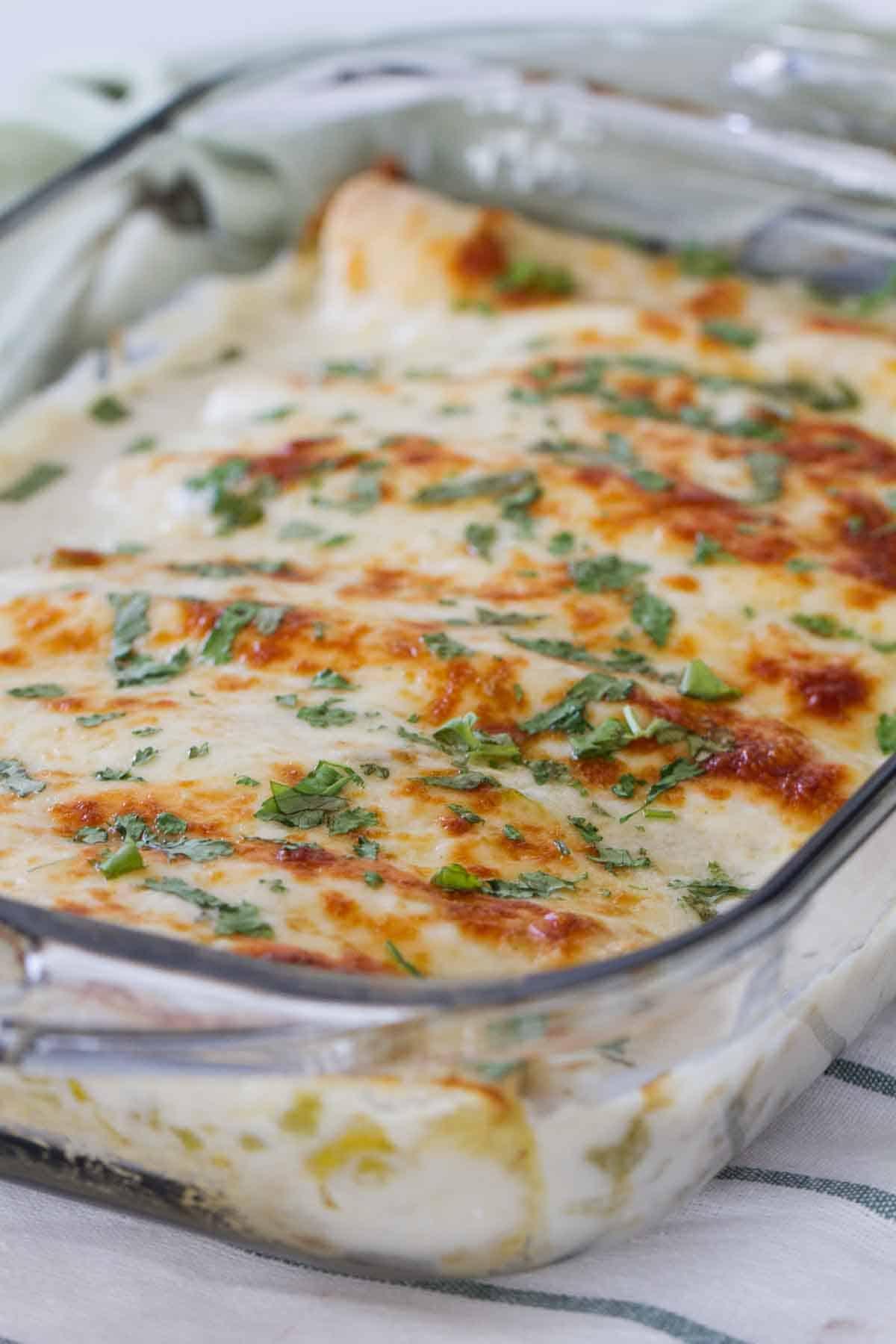 casserole dish with white chicken enchiladas
