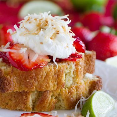 Strawberry Lime Shortcakes with Coconut Cream - Slices of perfect sour cream pound cake are topped with strawberries soaked in a lime syrup and a light coconut cream in this perfect summertime dessert.