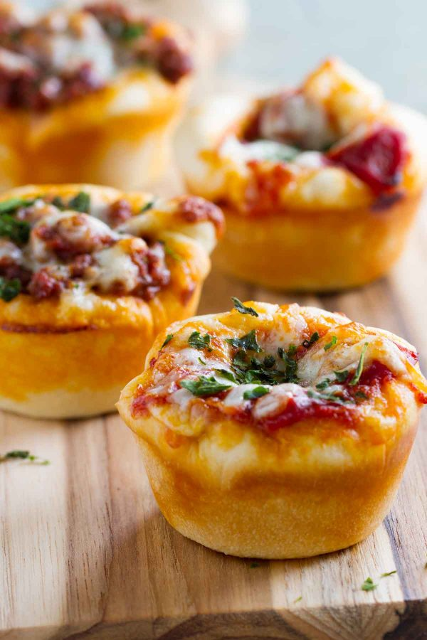 The kids will love these fun Pizza Cups - an easy twist for pizza night! They are also great for lunch on the go or for after school snacks!