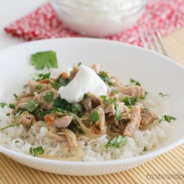 Slow Cooker Salsa Pork - pork roast is slow cooked with salsa verde and vegetables and then served over rice in this easy dinner recipe.