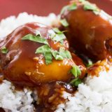 Slow Cooker Honey Garlic Chicken - chicken thighs are slow cooked in an easy honey garlic sauce, then served over rice. This proves that dinner doesn't have to be complicated to be good!