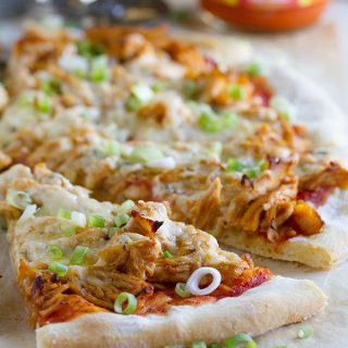 Spice up your pizza night with this Buffalo Chicken Pizza that has buffalo sauced chicken, Monterey Jack cheese and blue cheese.