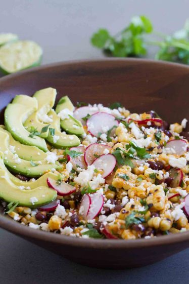This Grilled Corn and Black Bean Salad is the perfect meat-free summer meal - with grilled corn, black beans, radishes, green onions, cilantro, queso fresco and avocados.
