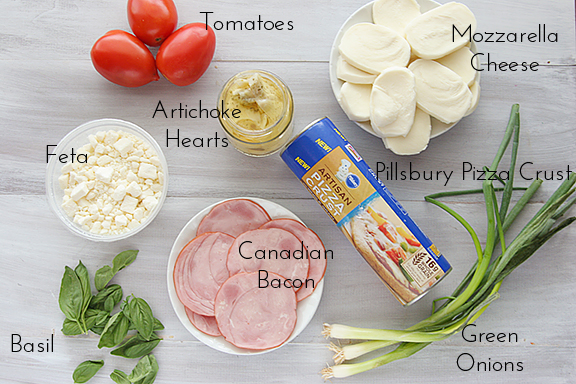Pizza with Canadian Bacon and Artichokes   www.tasteandtellblog.com