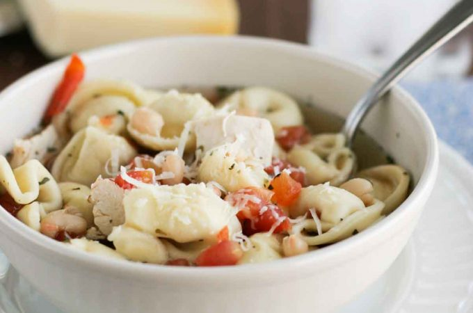 Perfect for a cold night, this Easy Chicken Tortellini Soup is filled with chicken, bean and tortellini, and is done in no time!