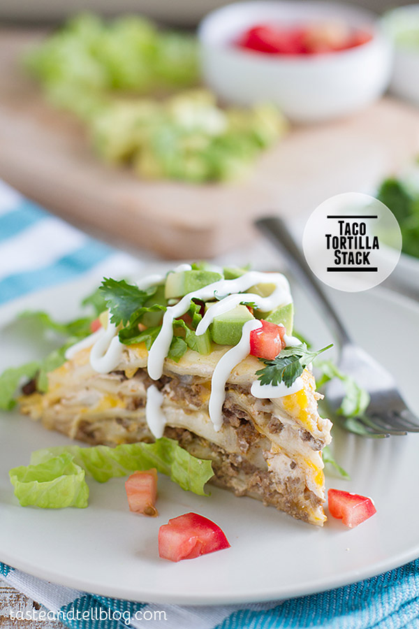 Taco Tortilla Stack - taco seasoned ground beef is layered with tortillas, a sour cream mixture, and lots of cheese in this fun Tex-Mex dinner recipe.