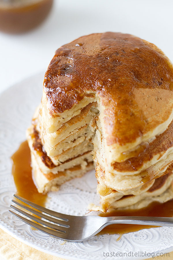Nothing says fall like apples! These pancakes are infused with apple cider, and then covered in a sweet and delicious caramel apple syrup for the perfect fall breakfast.