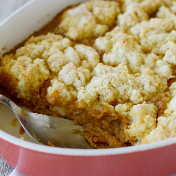 Cobblers aren't just for summer! A pumpkin custard is covered with a sweet biscuit topping in this fantastic Pumpkin Cobbler. Serve with ice cream for a different holiday dessert.