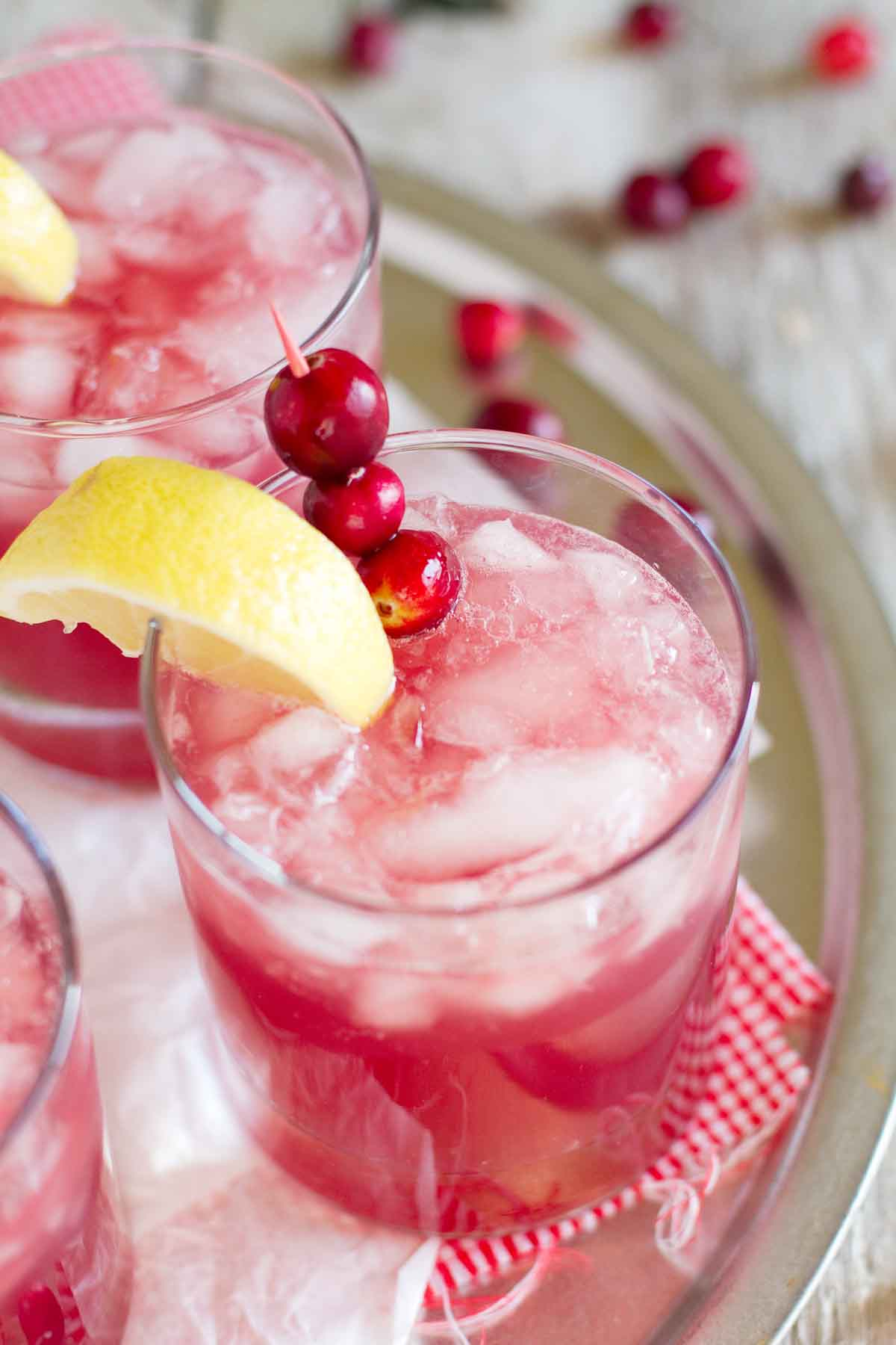 Sparkling Cranberry Punch in a glass with a lemon slice and fresh cranberries