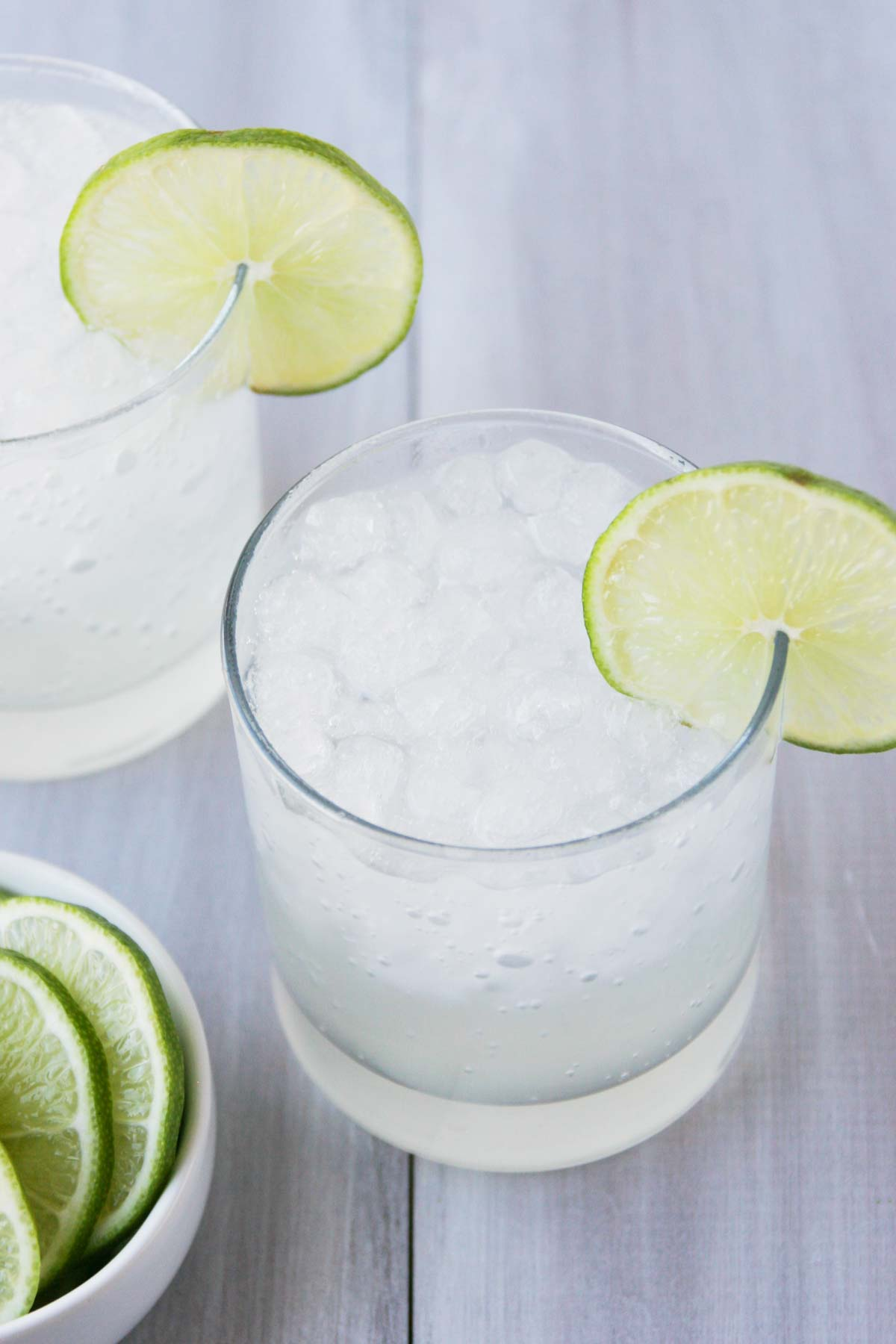mocktail made with ginger and lime in a cup with ice and lime slices