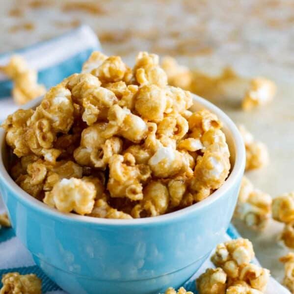 Baked Caramel Popcorn in a blue bowl