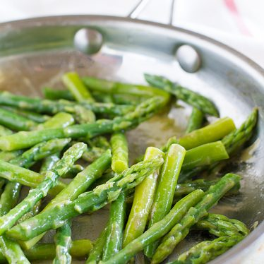 A simple side dish, this sauteed asparagus recipe is finished off with a maple syrup and mustard drizzle.
