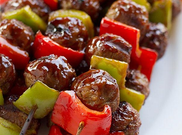 Sweet and Sour Meatball Skewers - These easy meatball skewers are made with frozen meatballs and sweet peppers and then basted with a simple sweet and sour sauce for a fast weeknight meal.