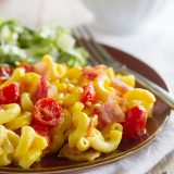 BLT Baked Mac and Cheese - Forget boring mac and cheese! This baked mac and cheese combines cheesy macaroni with bacon and tomatoes, and then is served with a simple romaine salad.