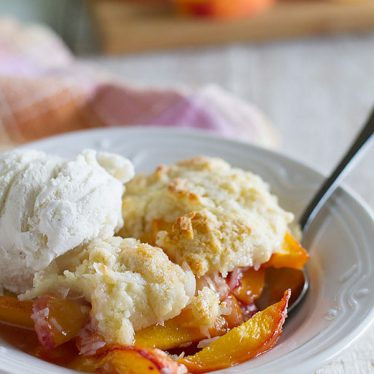Peach cobbler is a summer staple, and this Coconut Peach Cobbler recipe takes a traditional peach cobbler and gives it a delicious coconut twist.
