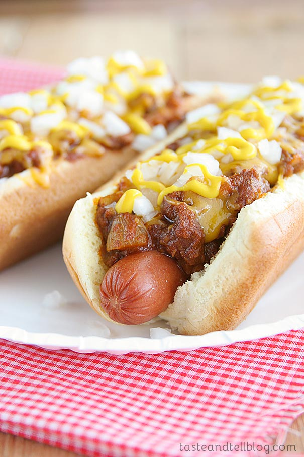 A classic chili dog – these Coney Island Hot Dogs are a beef hot dog on a bun, topped with a beef chili, onions and mustard.