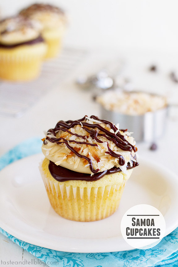Samoa Cupcakes - Everyone's favorite Girl Scout cookie in cupcake form! A yellow cupcake is filled with caramel then topped with chocolate ganache, caramel buttercream and toasted coconut.