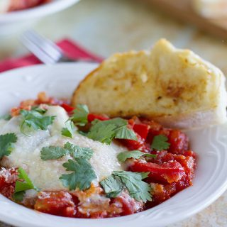 Eggs in Purgatory - Eggs are poached in a spicy tomato sauce in these Eggs in Purgatory – great for breakfast, brunch or dinner. Also known as Shakshuka.