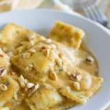 Ravioli with Pumpkin Alfredo - Pumpkin, sage and nutmeg add a warm richness to this Alfredo recipe that is served over ravioli for a comforting and easy fall or winter dinner.