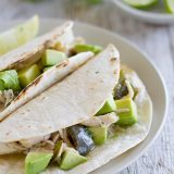 Easy Slow Cooker Chicken Tacos - chicken thighs are cooked all day in a salsa verde sauce for easy yet amazing tacos.