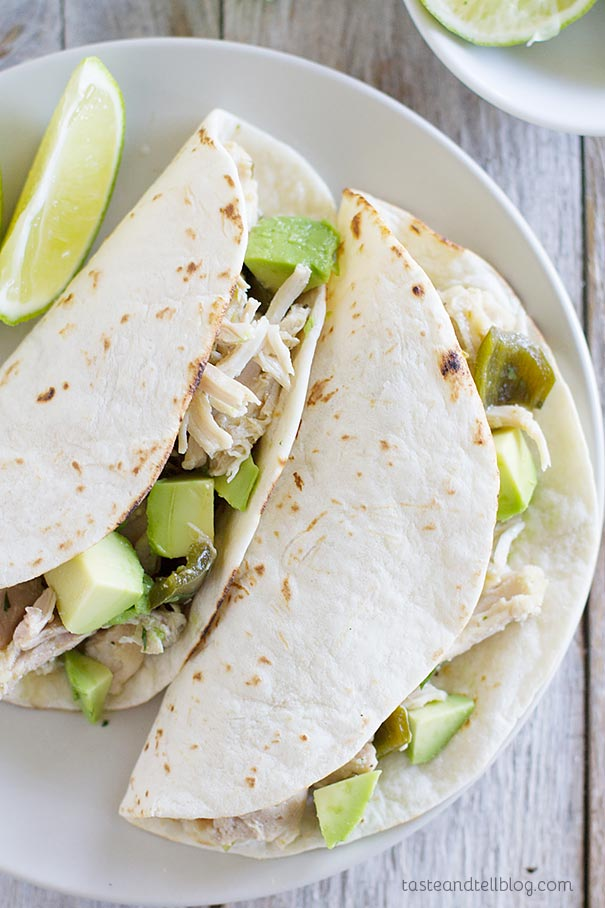 Slow Cooker Chicken Tacos - chicken thighs are slow cooked in an easy tomatillo salsa mixture.